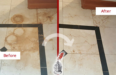 Before and After Picture of a Jamaica Plain Marble Floor Honed to Remove Rust Stains